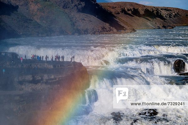 People on the edge of the waterfall of Gullfoss  one of the largest and mighty waterfalls of Iceland Golden Circle Southeast Iceland Iceland  Scandinavia  Europe