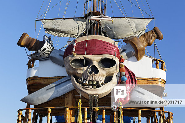 Excursion boat  pirate ship with a skull decoration in the port of Alanya  Antalya  Turkish Riviera  Turkey  Asia