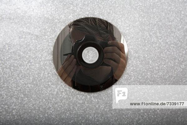 CD-reflektierender Fotograf