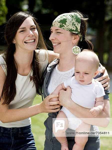 baby with her mother and aunt