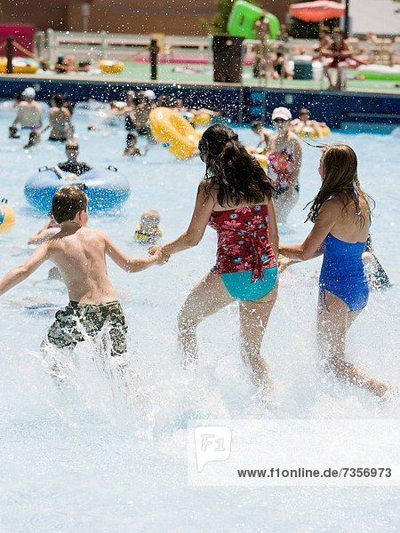 mother and two children at a waterpark