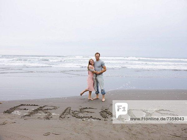 Freundschaft  schreiben  Strand  Wort  Sand  jung