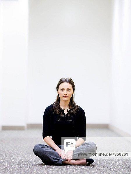 businesswoman sitting cross_legged on the floor