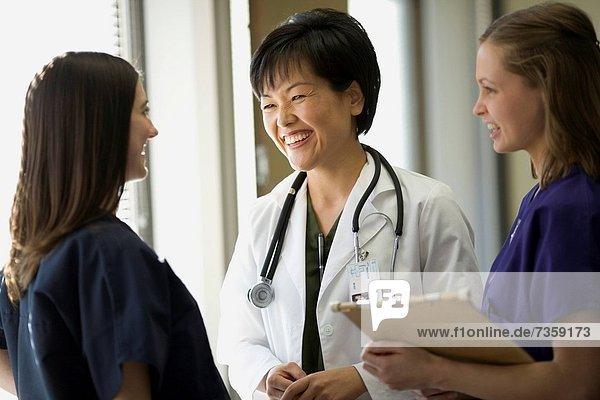 Three female doctors talking