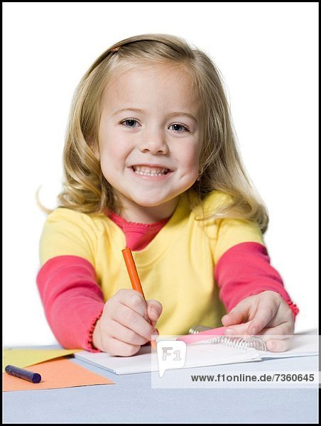 Portrait of a girl coloring with crayons
