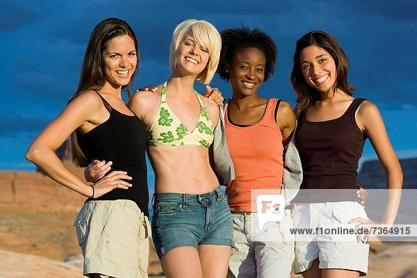 Portrait of four young women smiling