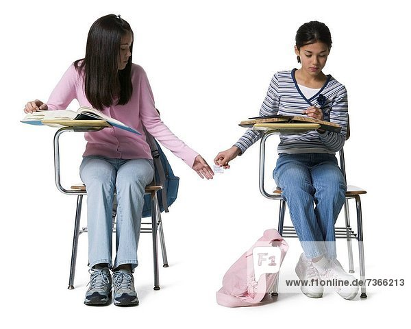 Two girls copying in an examination