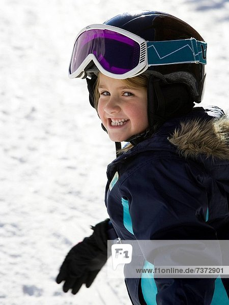 Young girl outdoors in winter with ski goggles