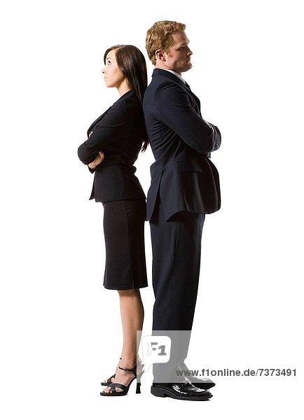 Kaufmann und geschäftsfrau Rücken an Rücken stehend