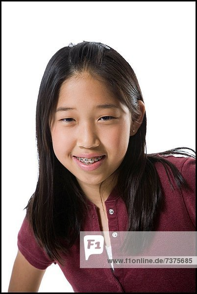 Close_up of a teenage girl smiling
