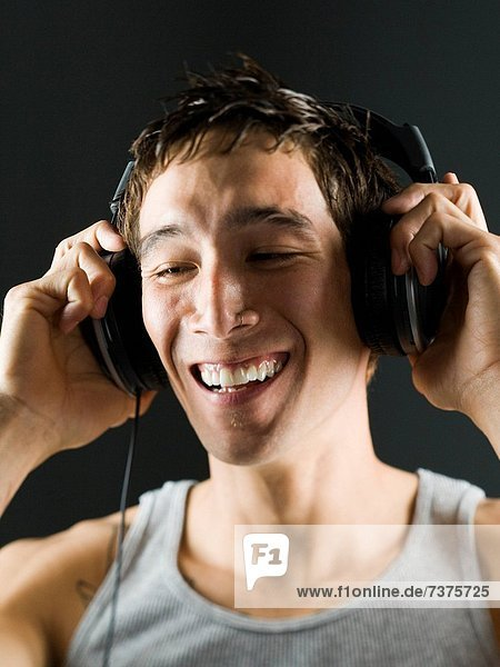 Close_up of a young man with headphones on