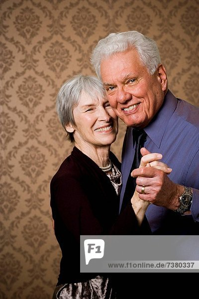 Portrait of an elderly couple dancing