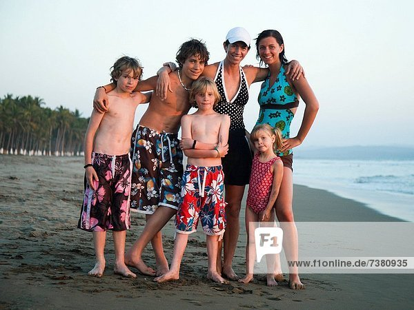 Mother with sons and daughters on beach