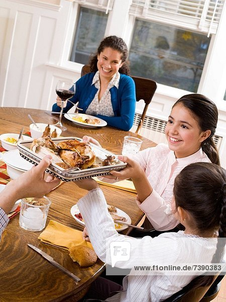 Family at dinner table smiling