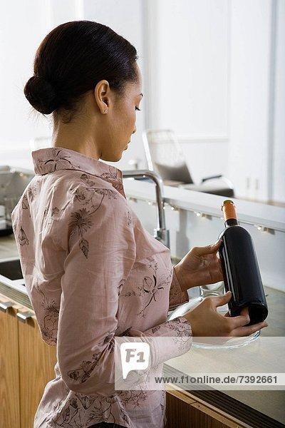 Woman opening a bottle of wine