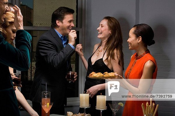 Partygoers eating