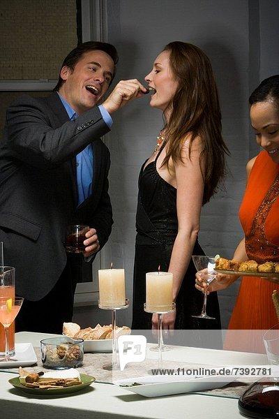 Partygoer eating