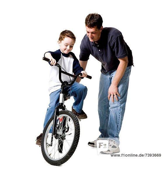 Menschlicher Vater  Sohn  Fahrrad  Rad