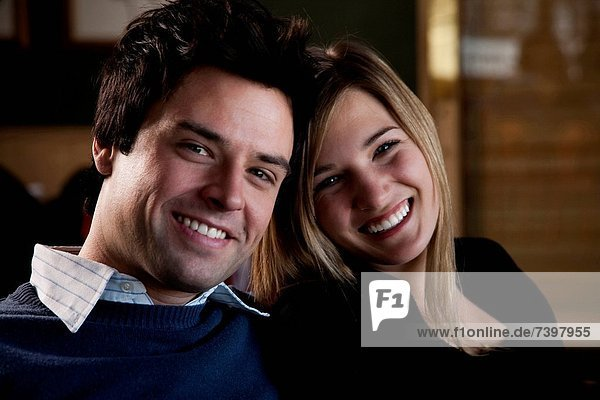 Couple sitting close and smiling