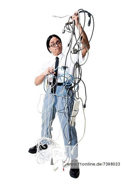 Office worker with tangled mess of wires