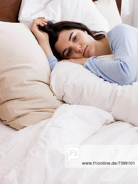 Vereinigte Staaten von Amerika  USA  liegend  liegen  liegt  liegendes  liegender  liegende  daliegen  Frau  Bett  jung  Utah