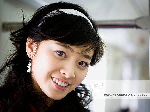 Closeup of teenage girl smiling
