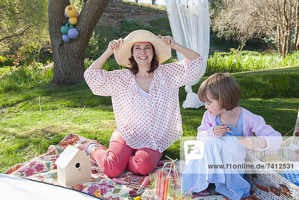 Mother and daughter having picnic