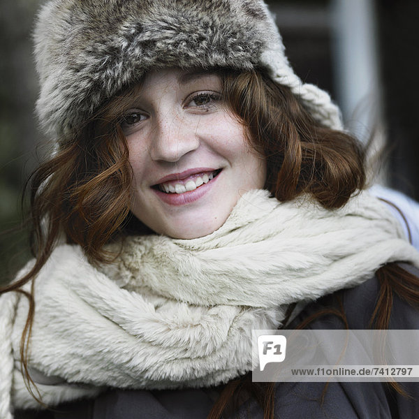 Smiling woman wearing hat and scarf