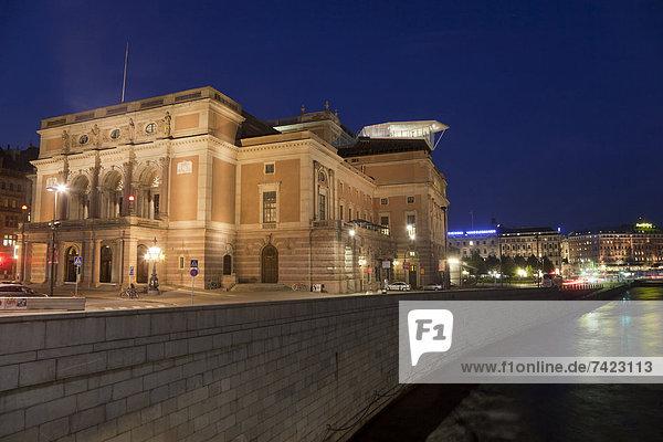 City opera house illuminated at night  Royal Swedish Opera  Norrstrom River  Stockholm  Sweden  September