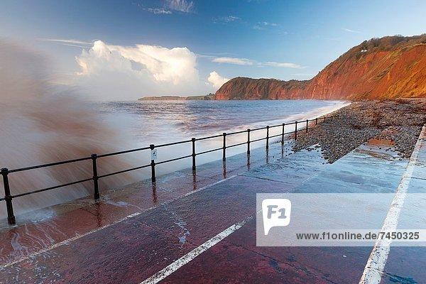 Waves crashing against walkway in Sidmouth  Devon  England  United Kingdom  Europe
