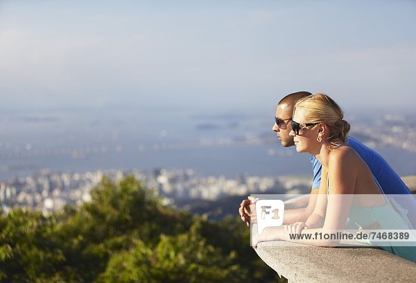 Couple enjoying view of Rio from Corcovado  Rio de Janeiro  Brazil  South America