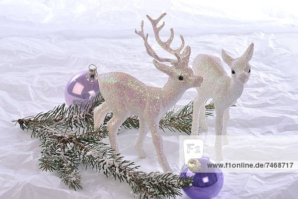 Deer figurines,  Christmas baubles and fir branch
