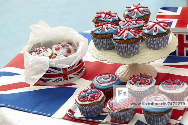Cup cakes with red  white and blue icing