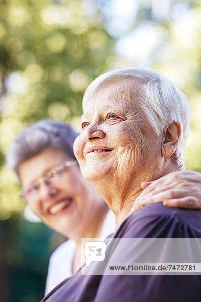 Older women smiling together outdoors