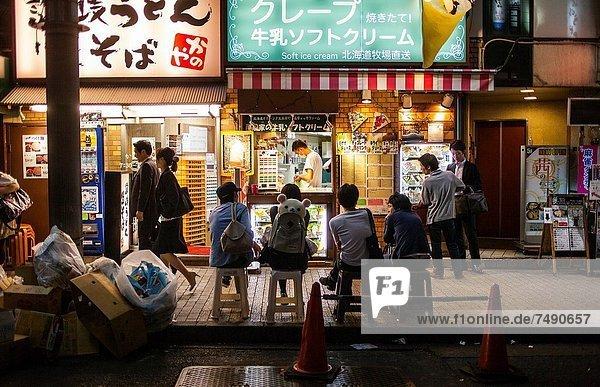 Street scene  next to Shinjuku station  Shinjuku  Tokyo City  Japan  Asia