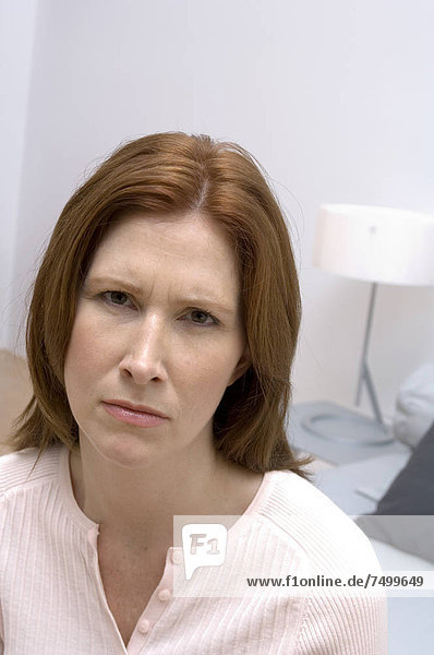 Portrait of woman looking infuriated.