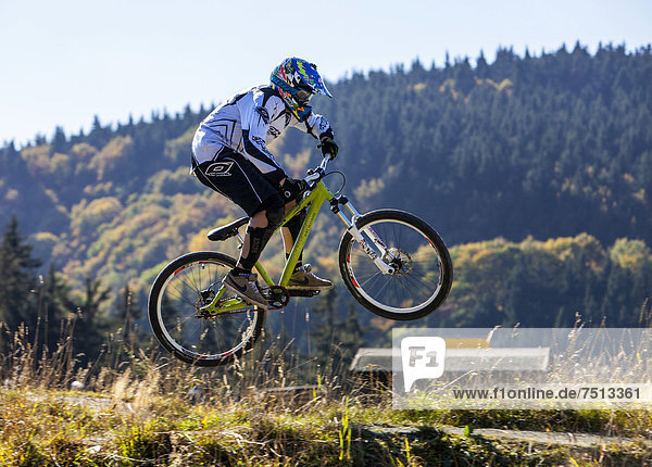 Bike park  downhill mountain bike trail at the Winterberg bobsleigh track  a converted ski lift is used to transport mountain bikers and their bikes up the mountain  Sauerland  North Rhine-Westphalia  Germany  Europe
