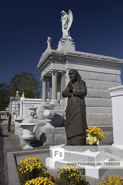 A statue of Mother Teresa in St. Louis #3 Cemetery  New Orleans  Louisiana  USA