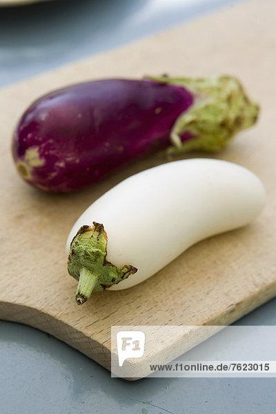 White and purple eggplants on board