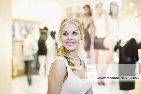 Smiling woman shopping in mall
