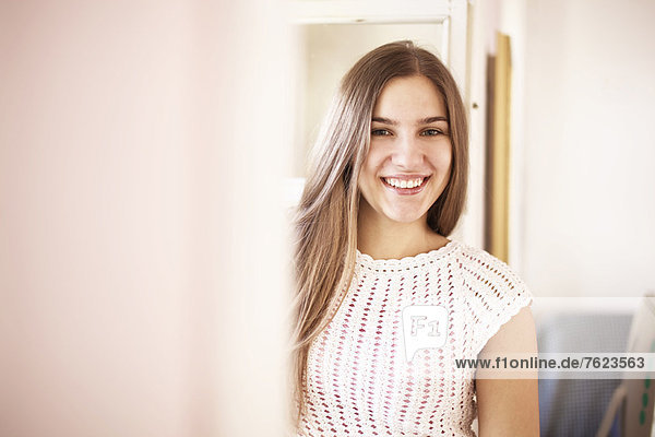 Smiling woman standing indoors