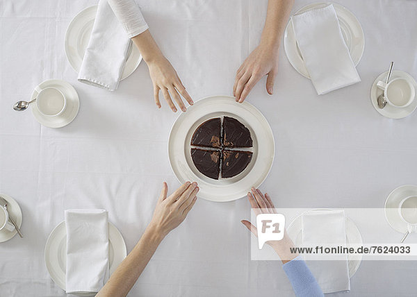 Overhead view of people sharing dessert