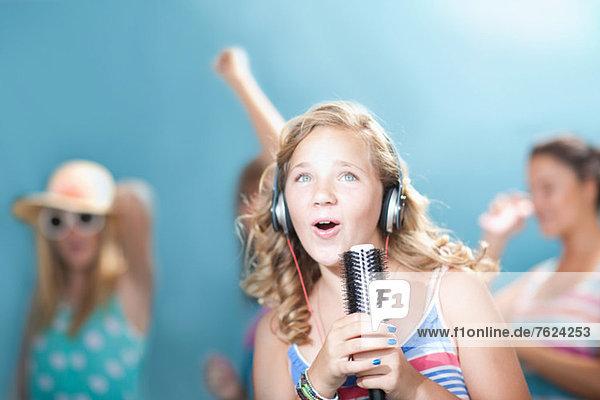 Girl singing into hairbrush