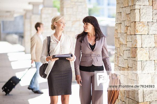 Businesswomen talking in walkway