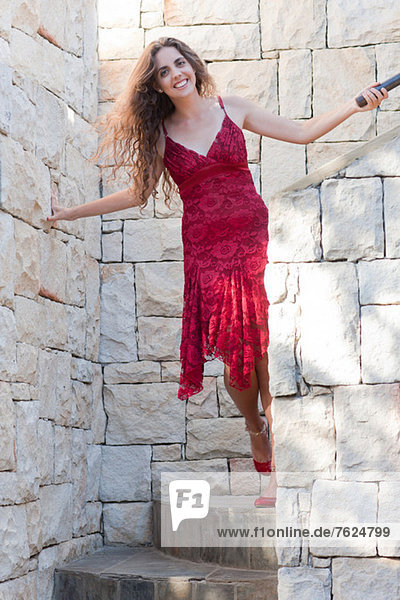 Woman climbing stone steps outdoors