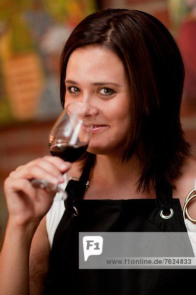 Server tasting wine in grocery store