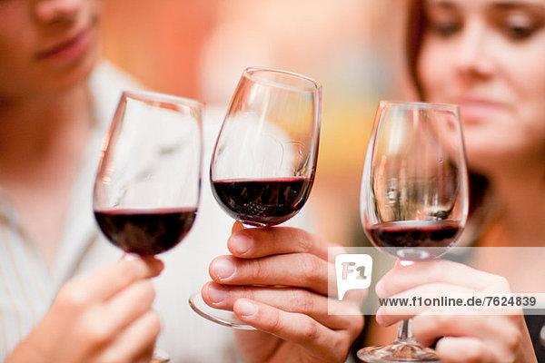 Friends tasting wine in grocery