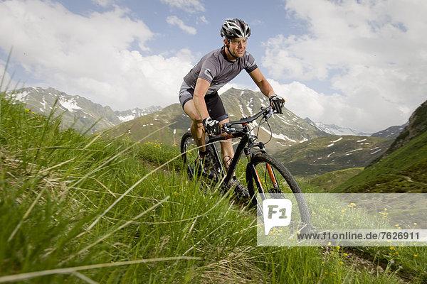 Mountainbiker in the Alps  Andermatt  Switzerland