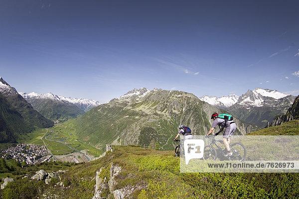Two mountainbikers in the Alps  Andermatt  Switzerland