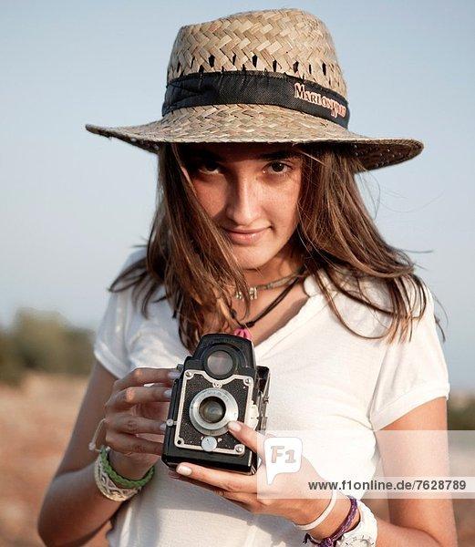 girl with hat and camera  girl with hat and camera